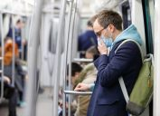 Man wearing a face mask on a subway
