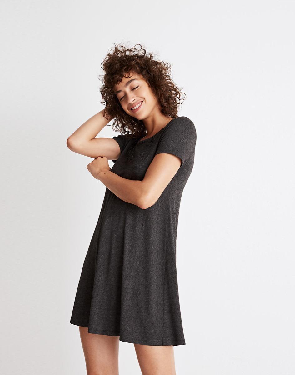 young woman wearing black t-shirt dress