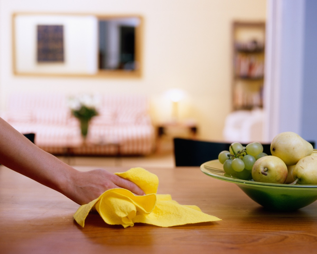 Wiping down dining table