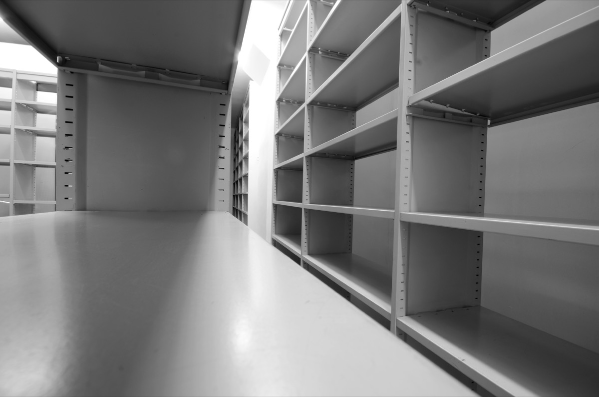 room full of tall shelving units