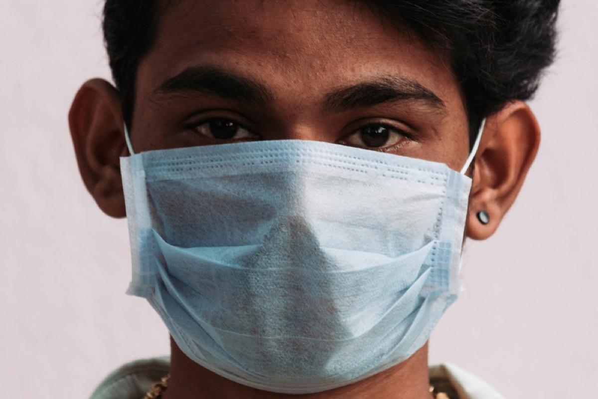 teen wearing mask