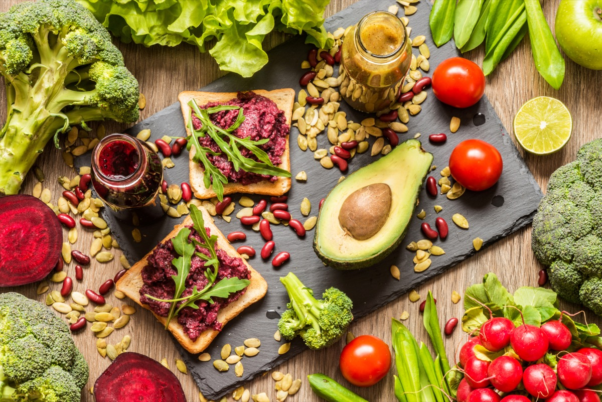 vegan food and ingredients on wooden table