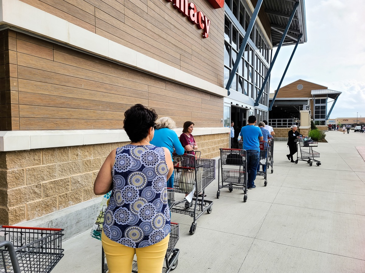 HOUSTON, TEXAS - March 13, 2020: Waiting Lines at Grocery Store due to Hoarding a Variety of Supplies, (such as water, paper products, eggs, and frozen food) in Pandemic Scare at a Walmart.