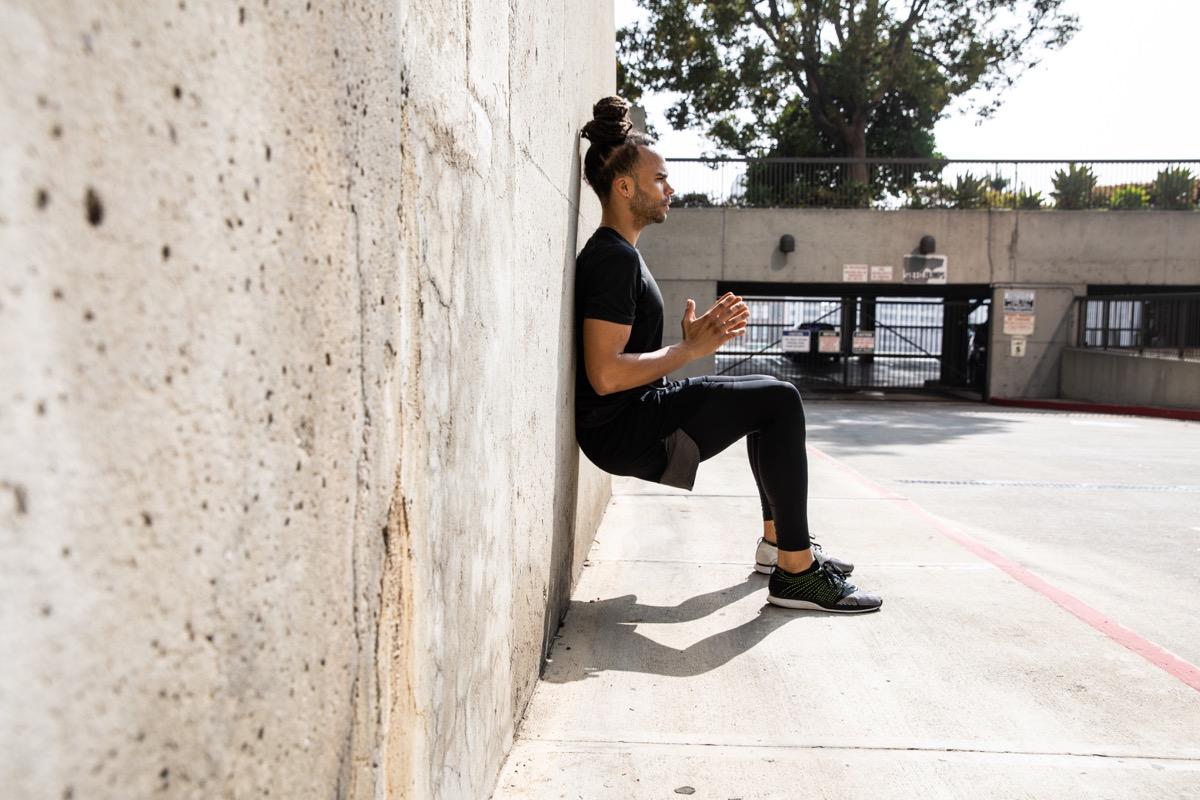 Man doing wall sits