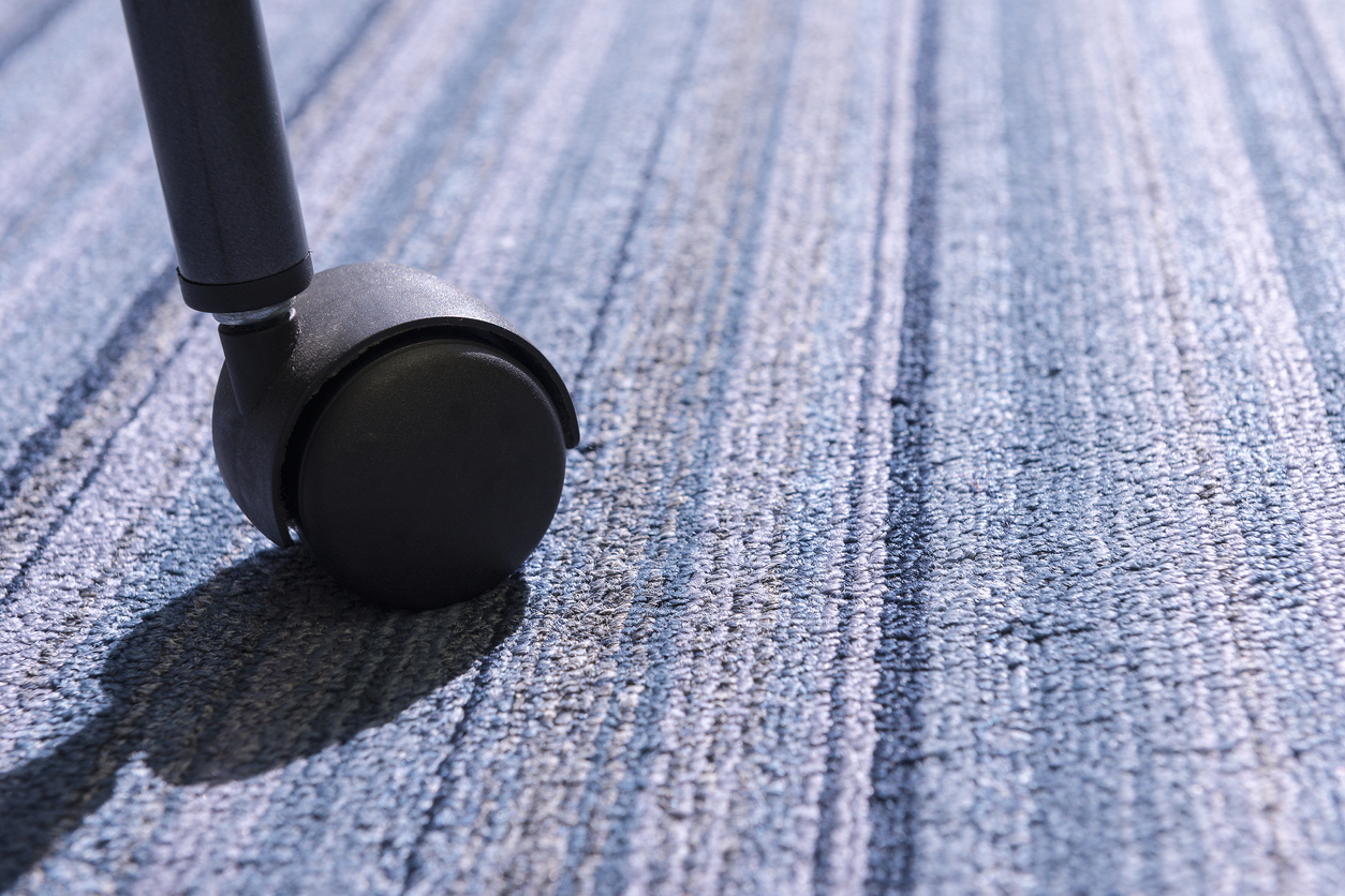 Close up of the Chair roller on the carpet