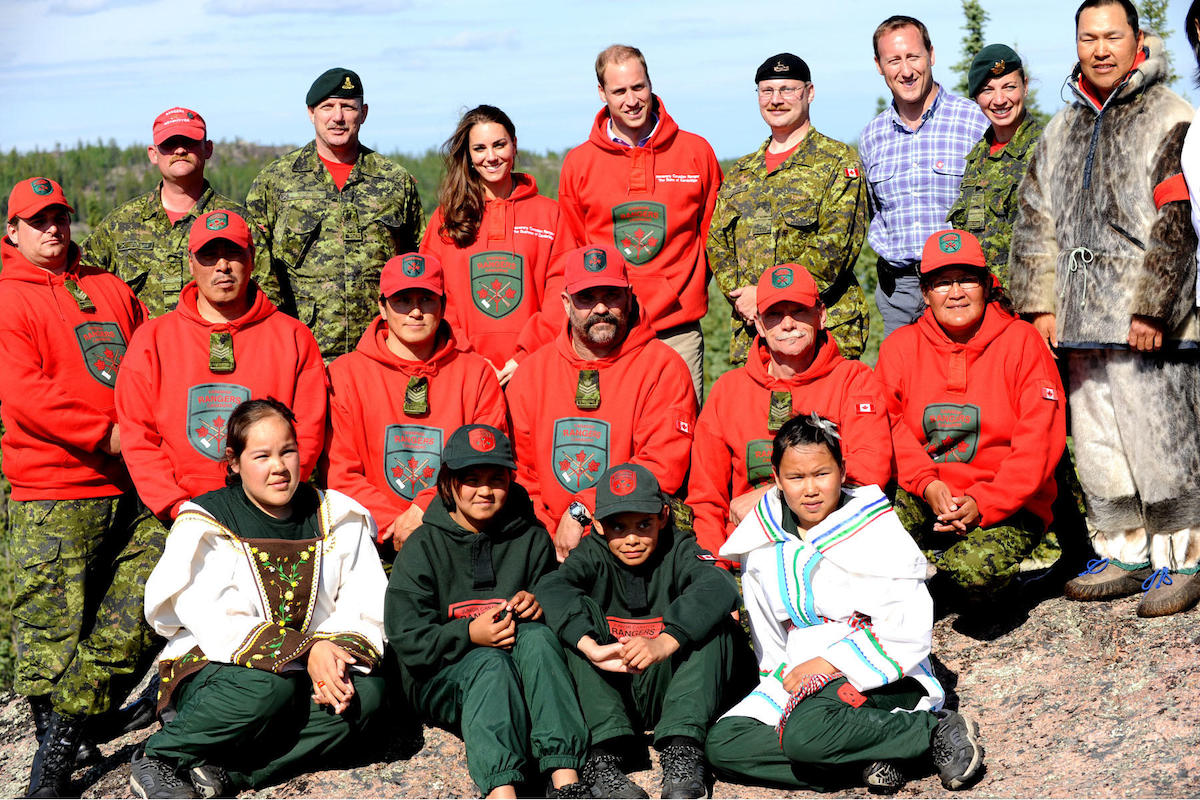 Prince William and his wife Kate, the Duke and Duchess of Cambridge (back centre) pose for a group photo with Canadian Rangers at Blachford Lake during their royal tour to Yellowknife, North West Territories, July 5, 2011