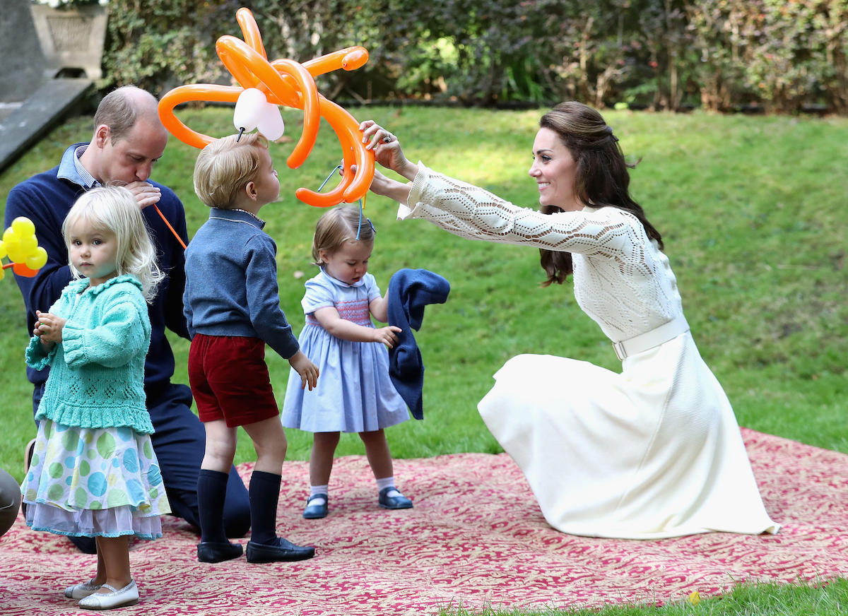 The Duke and Duchess of Cambridge with their children Prince George and Princess Charlotte at a children's party for Military families at Government House in Victoria during the Royal Tour of Canada in 2016