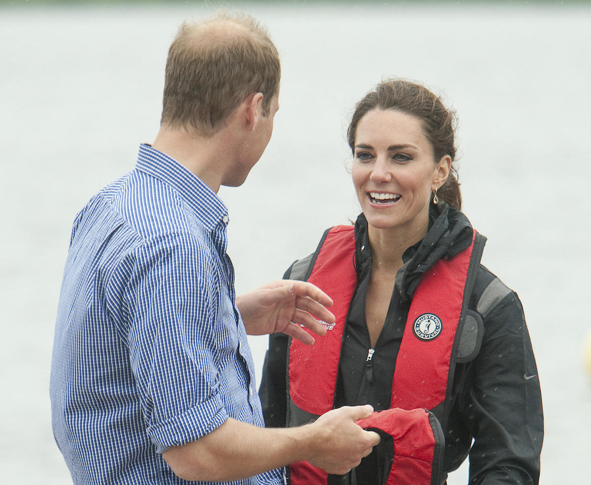 Prince William and his wife Kate, the Duke and Duchess of Cambridge, discuss his team beating hers in the dragon boat race across Dalvay Lake near Charlottetown, Prince Edward Island, July 4, 2011