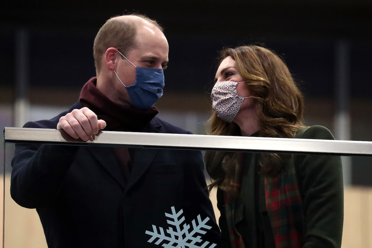 Prince William, Duke of Cambridge and Catherine, Duchess of Cambridge look on from the balcony at London Euston Station on December 06, 2020 in London, United Kingdom.