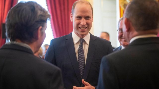 The Duke of Cambridge talks with guests during a Metropolitan and City Police Orphans Fund reception at St James's Palace, London, to mark the 150th anniversary of the Fund in Feb. 2020
