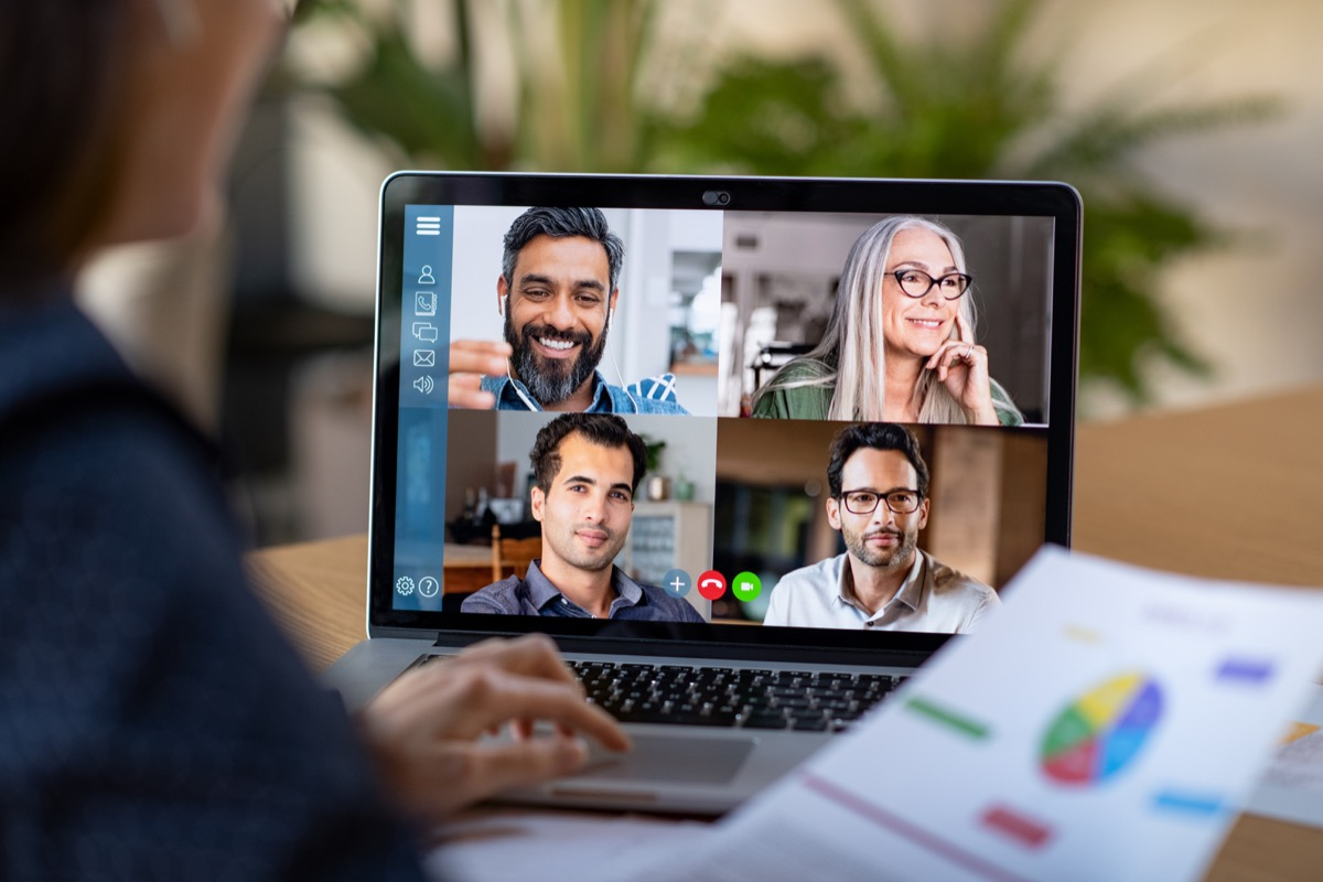 woman on five-way video call with coworkers at work