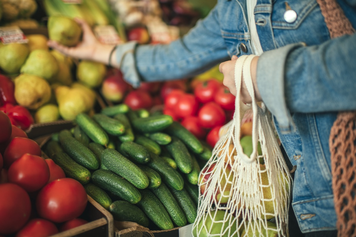 Close-up of ecologically friendly reusable bag with fruit and vegetables while grocery shopping