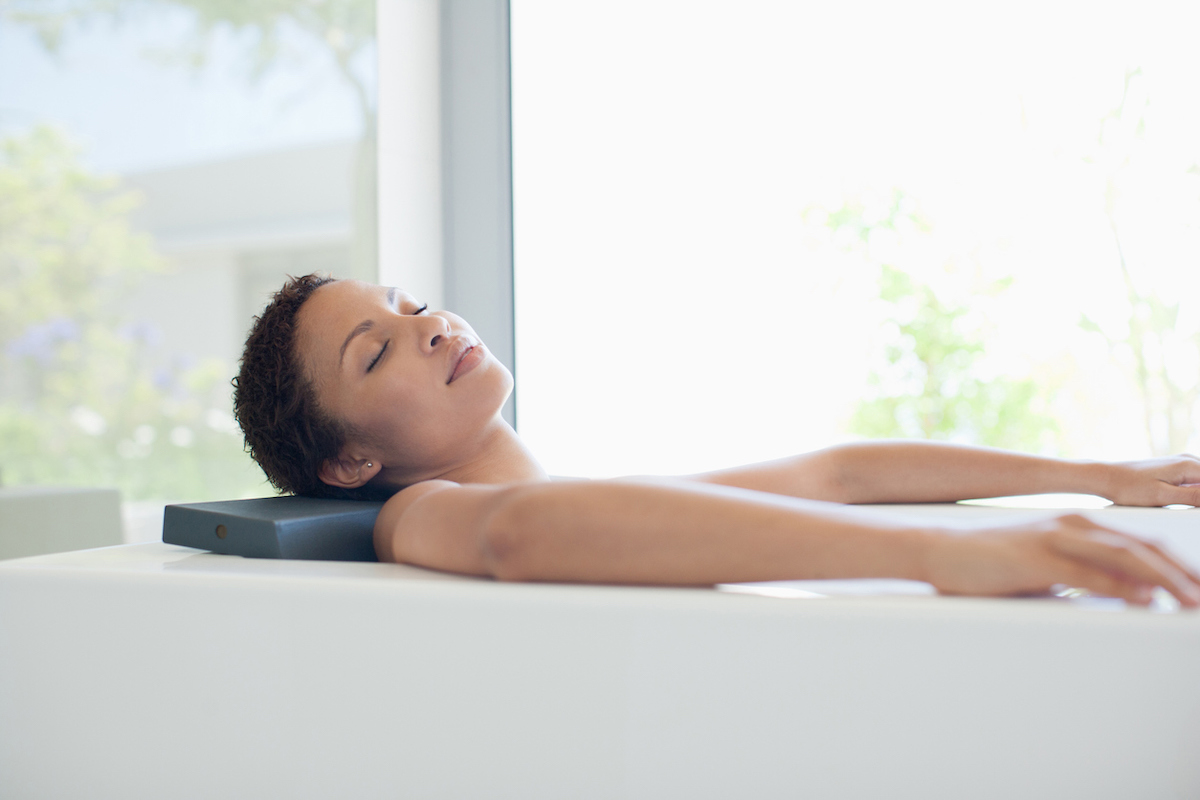 black woman in bath tub
