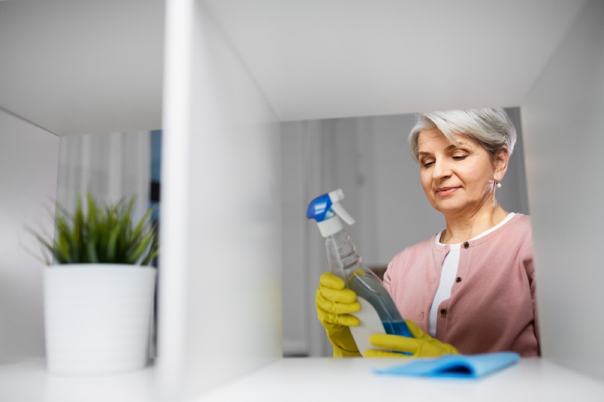 woman looking at bottle of cleaner