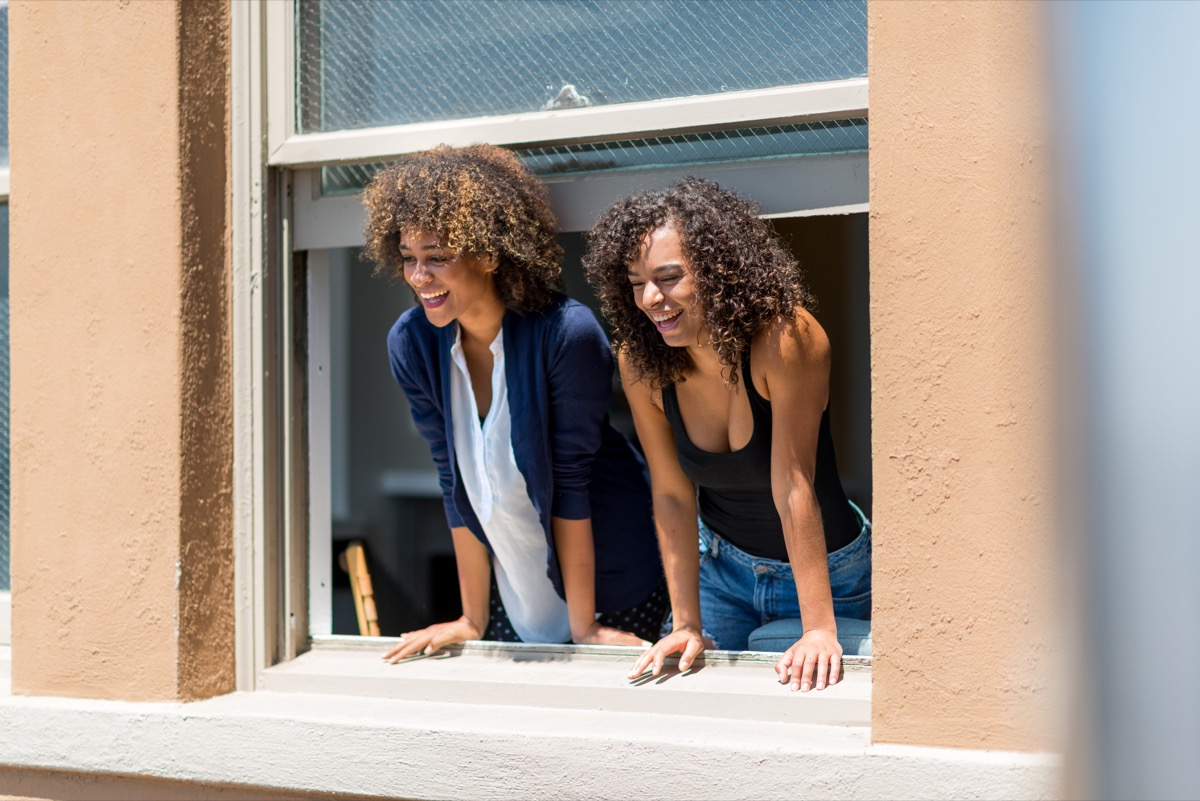 two women leaning out of their window