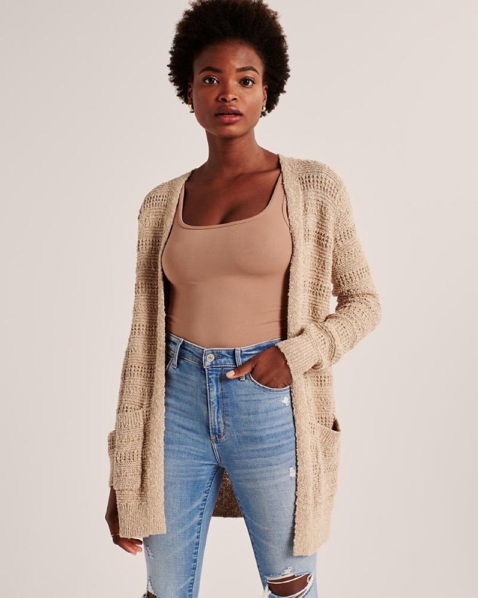 young black woman in open camel colored cardigan