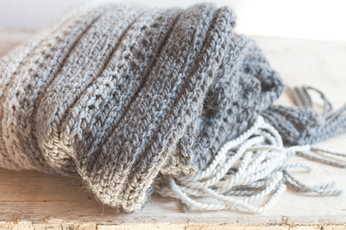 gray ombre wool scarf on wood