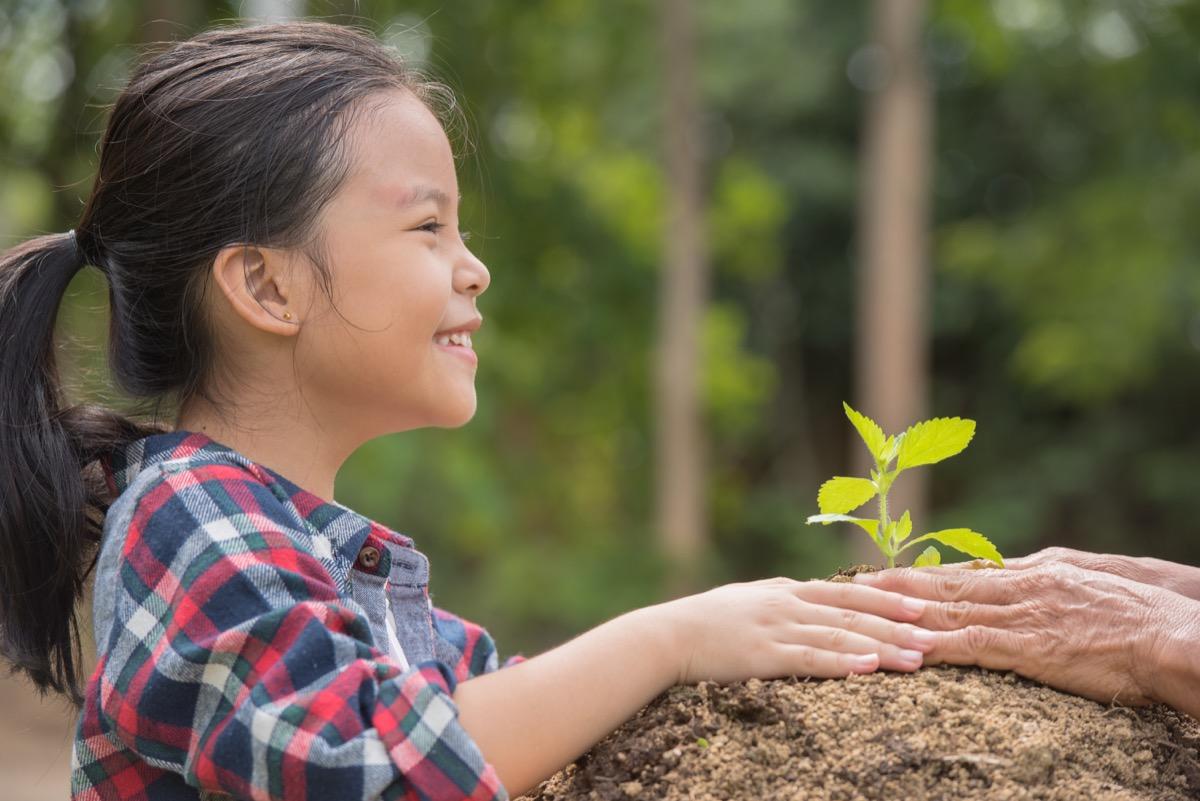 young asian girl gardening