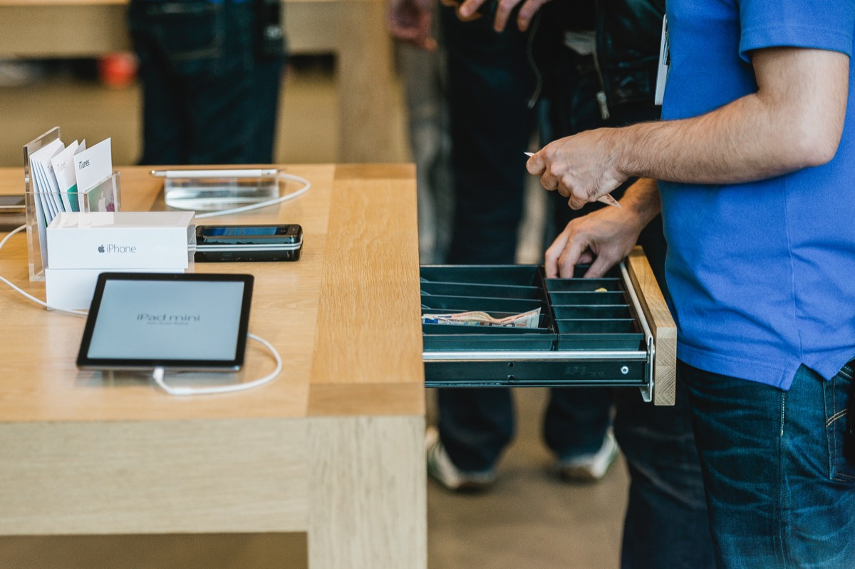 Apple store cashier with cash