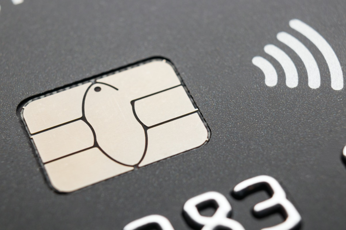 Credit card with contactless payment symbol