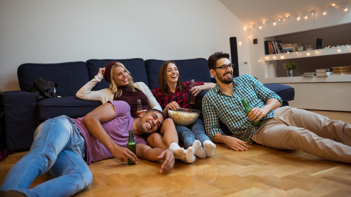 Two couples watching movie at home