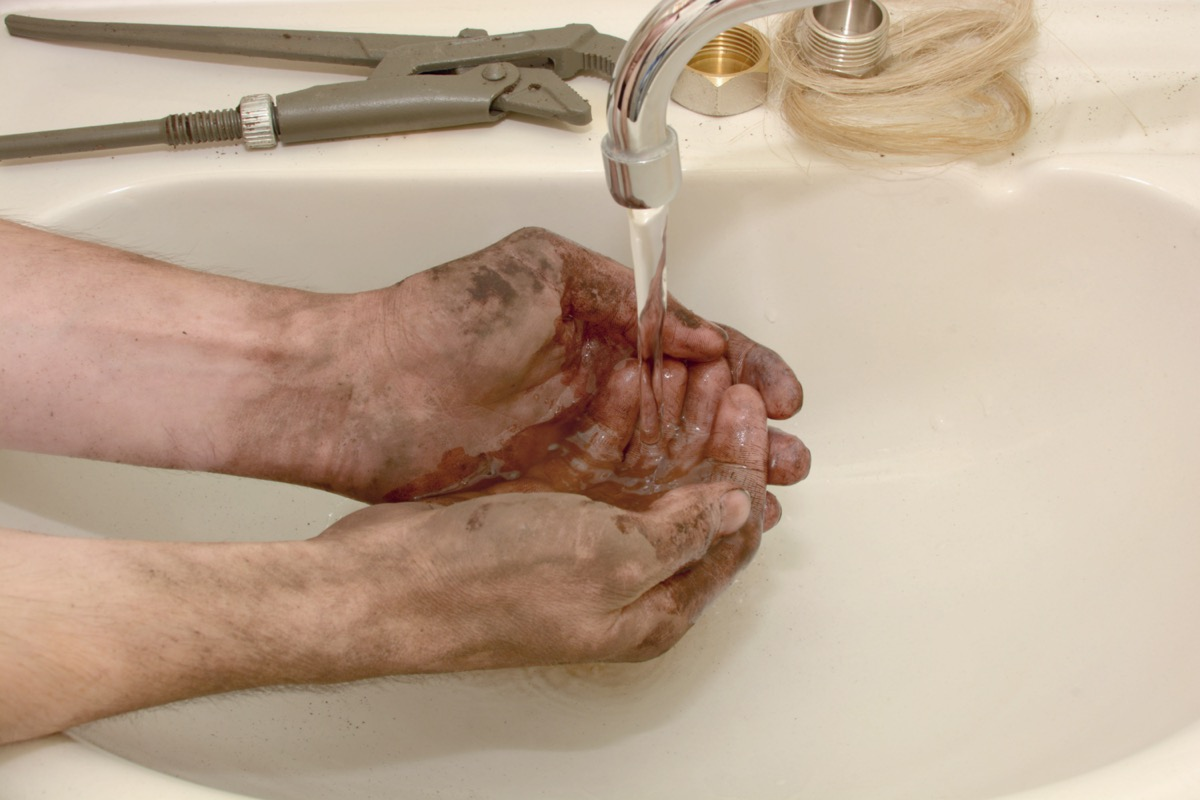 Washing dirty hands in sink