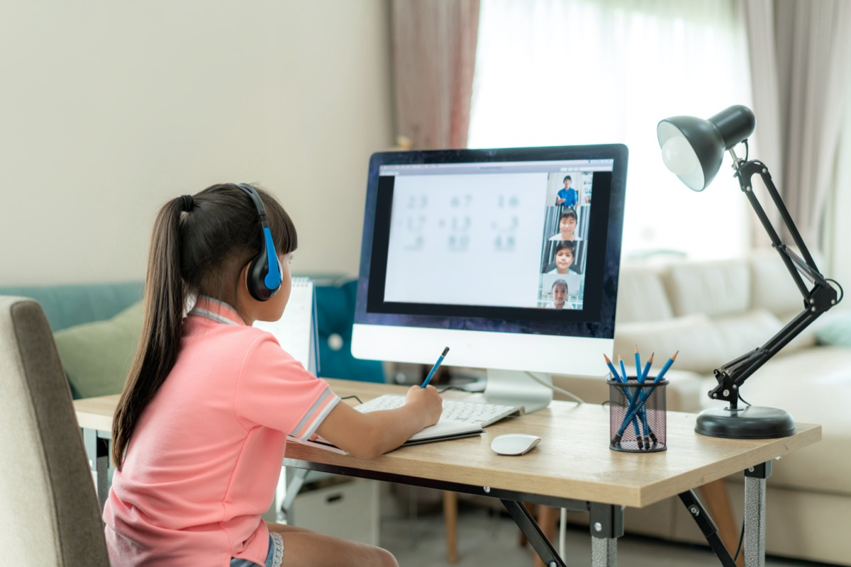 Young girl distance learning with computer