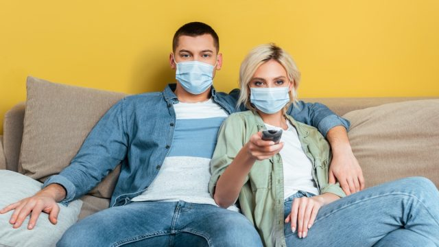 People watching TV with masks