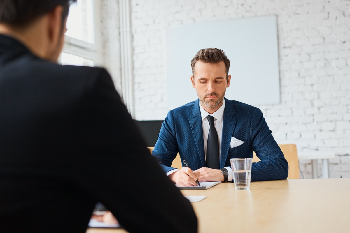 Two men meeting at conference room table