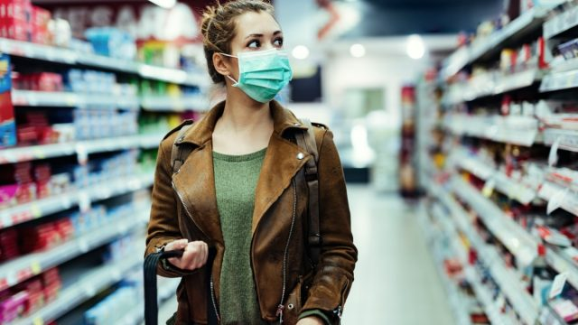 Woman at grocery store in face mask