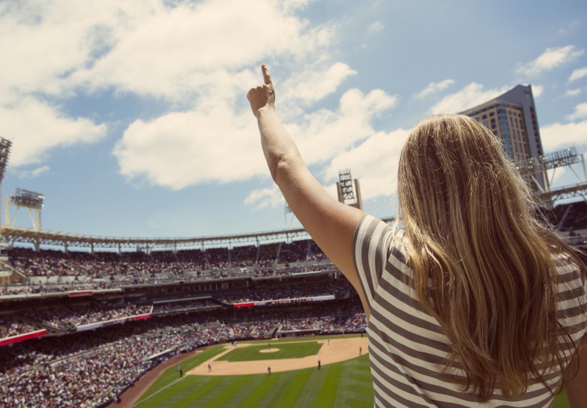 Woman cheering at baseball game