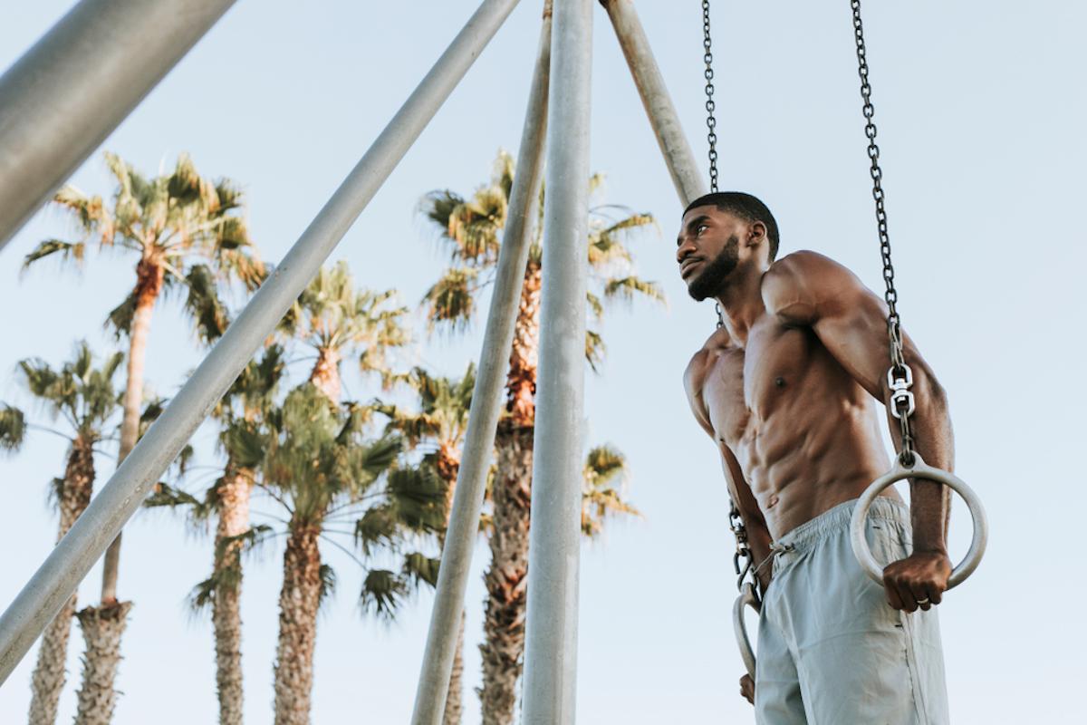 black man using beach gym