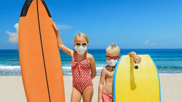 kids wear masks on beach