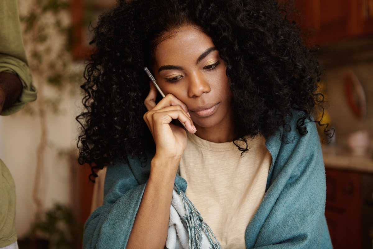 Woman talking to family on phone call