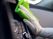 Person cleaning car interior