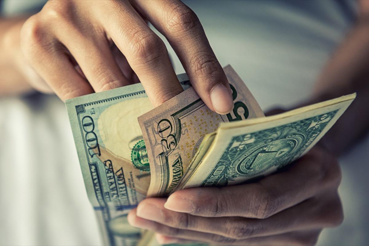 Hands touching paper money