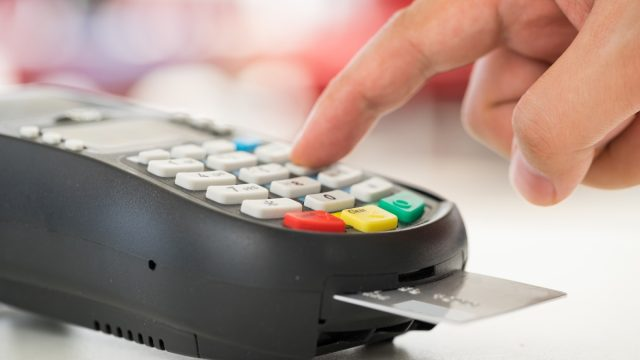 hand using chip credit card reader