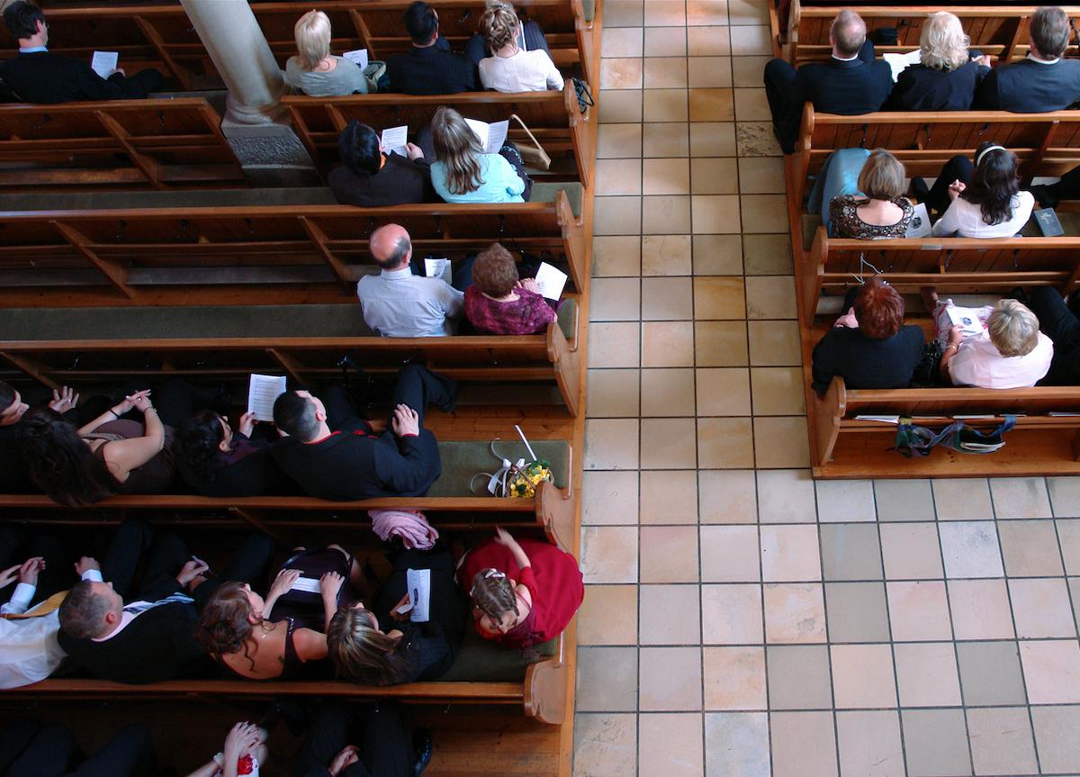 Congregation at church praying
