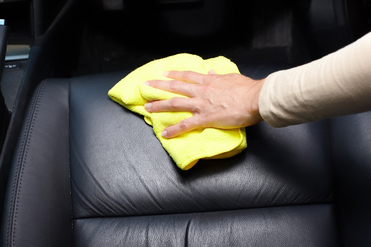 Cleaning car interior with towel