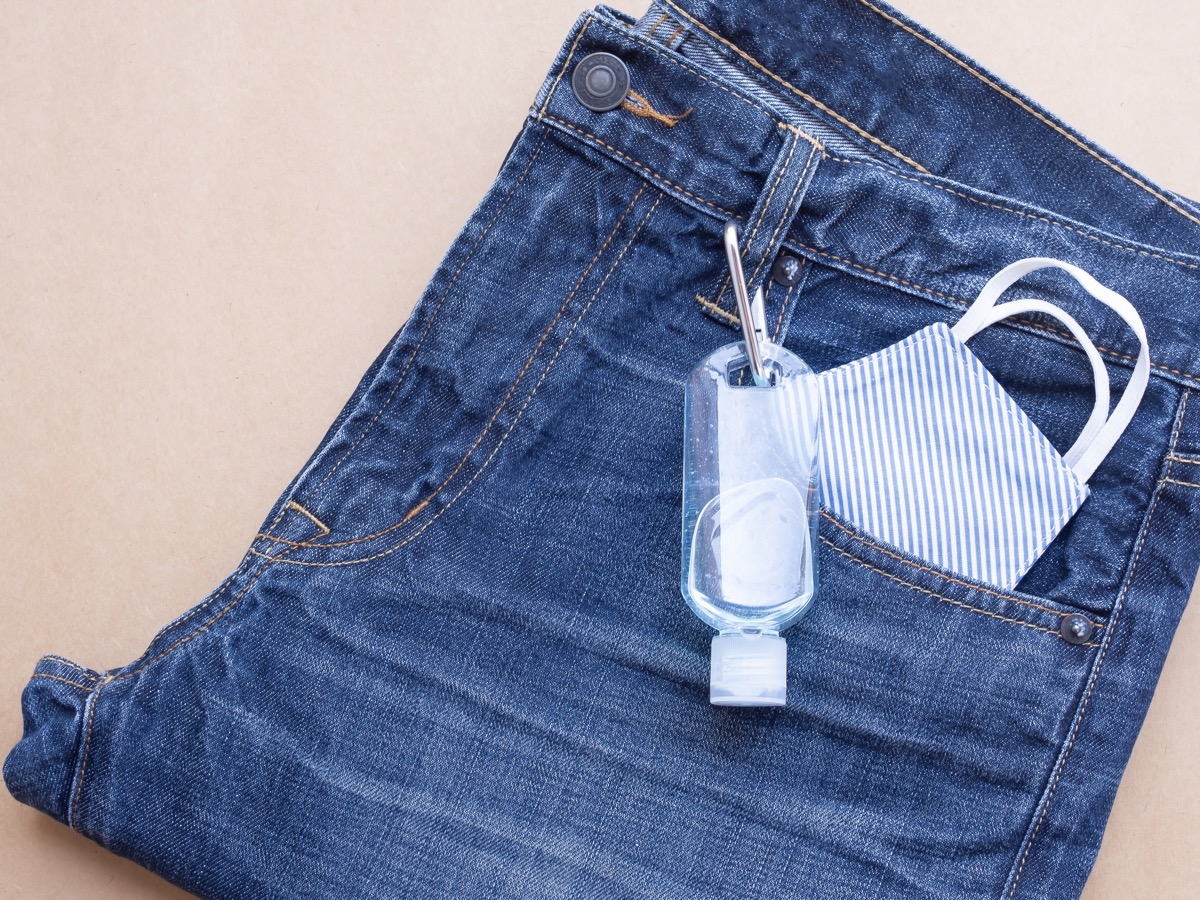 mask in the pocket of a pair of jeans