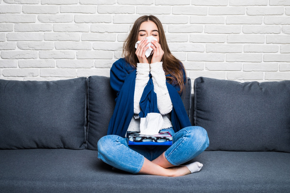 Sick woman on couch