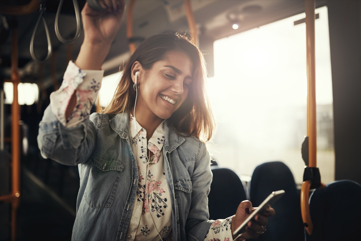 Woman listening to music on her commute to work