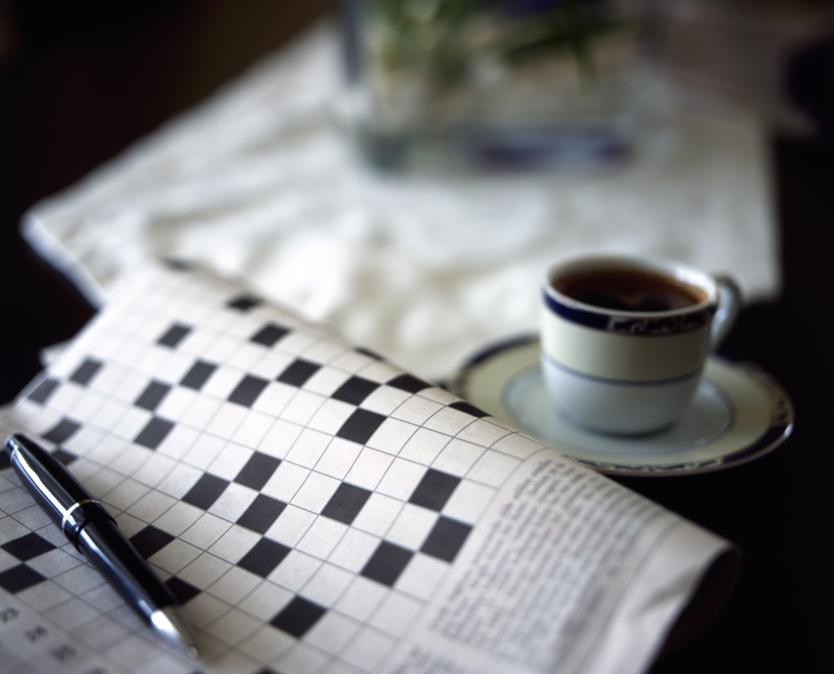 blankcrossword puzzle with a pen and black coffee