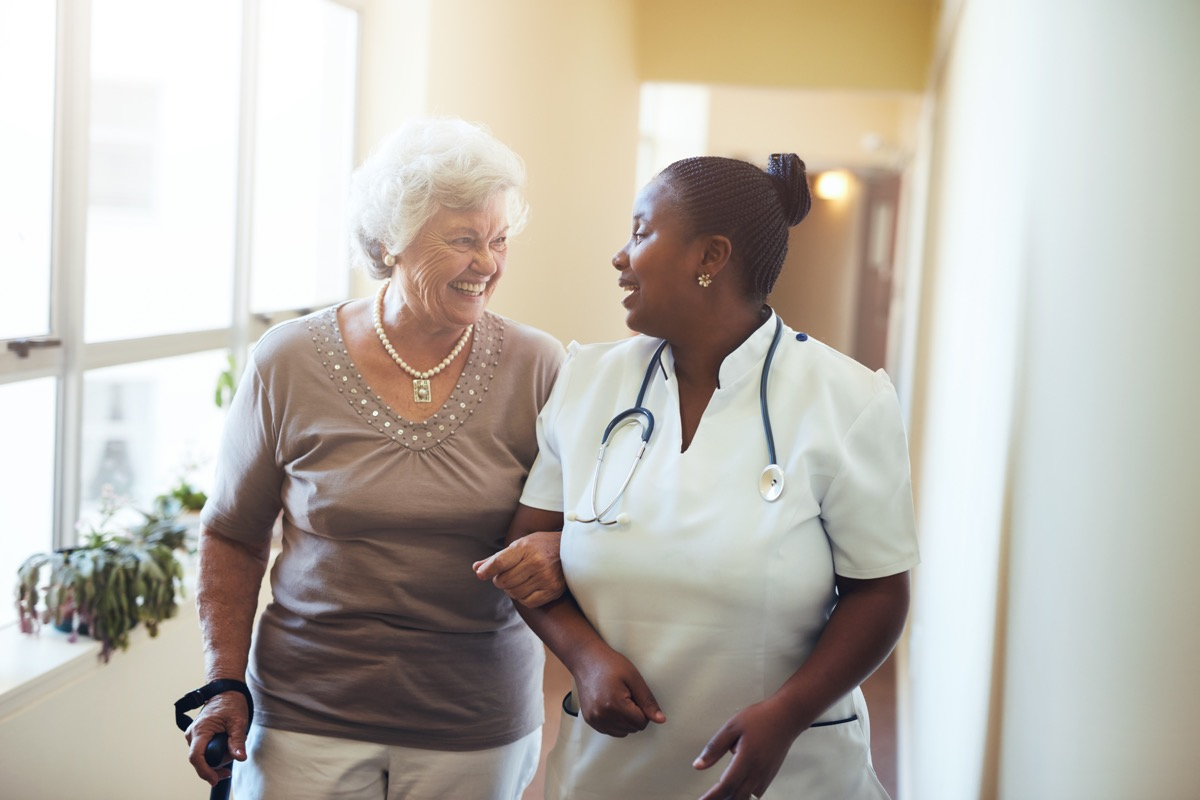 doctor or nurse and patient in nursing home