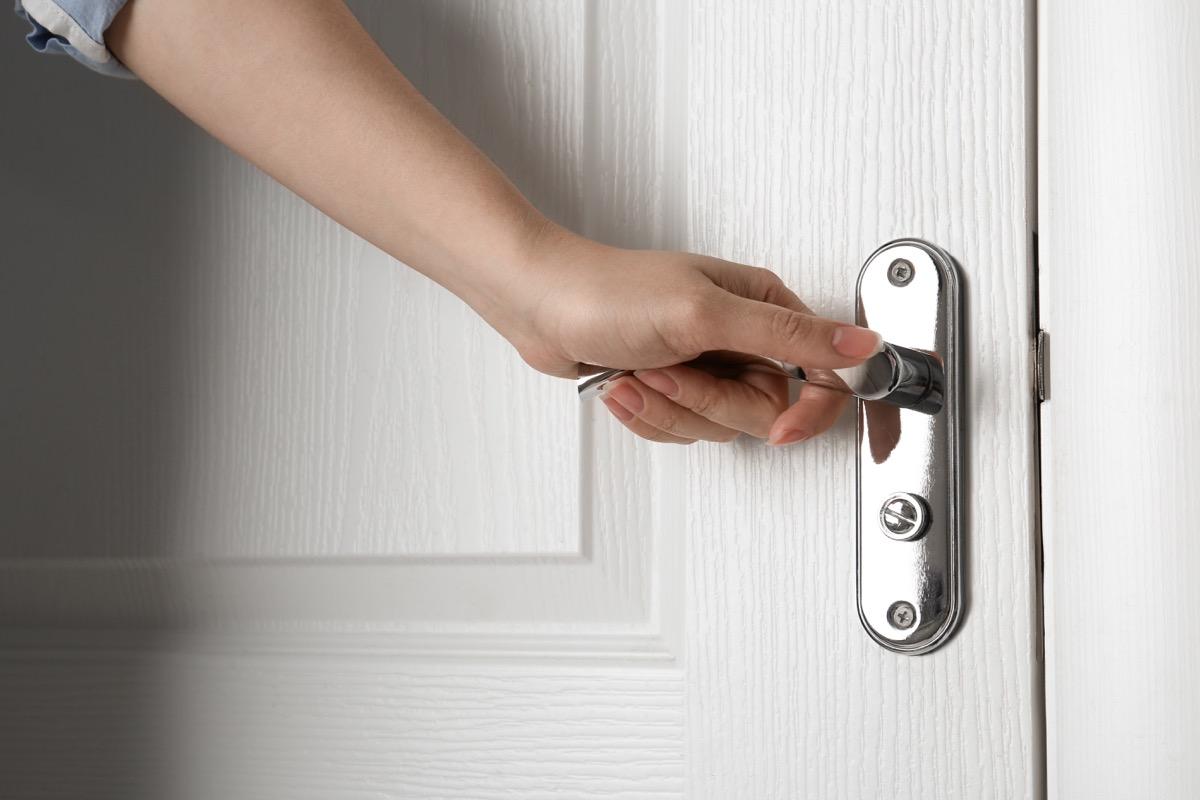 Opening door touching doorknob