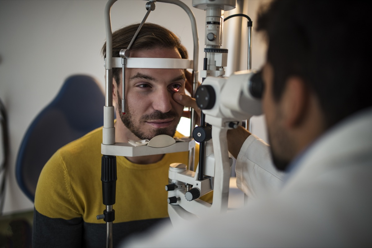 Young men having an eye exam at ophthalmologist's office.