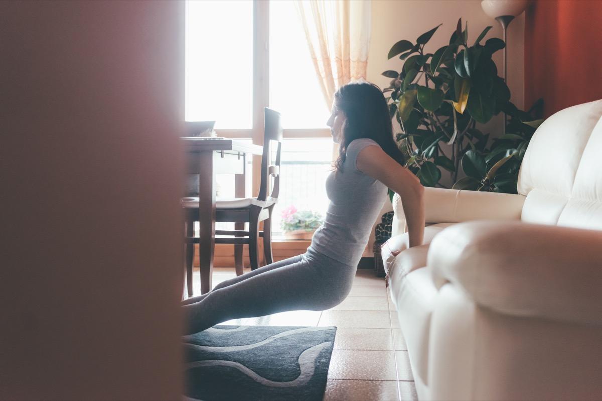 Woman exercising while watching TV
