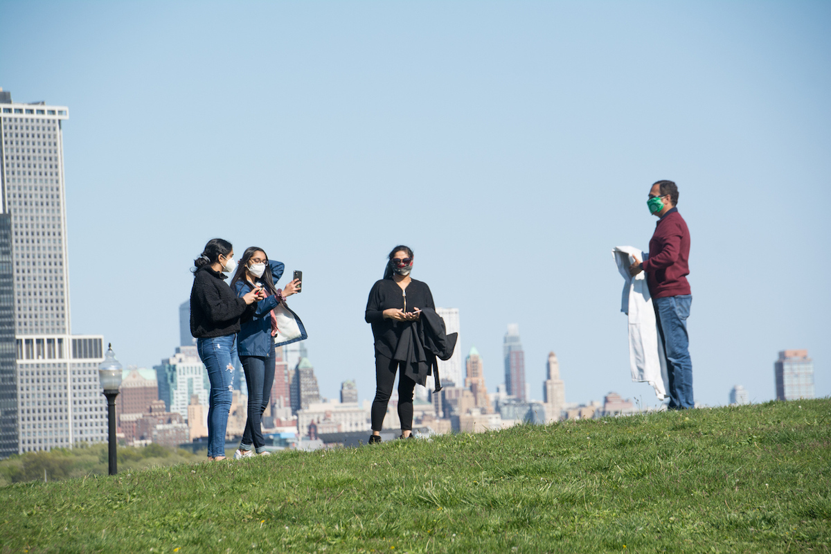A family prepares to have a picnic in Liberty State Park, during Covid-19 pandemic