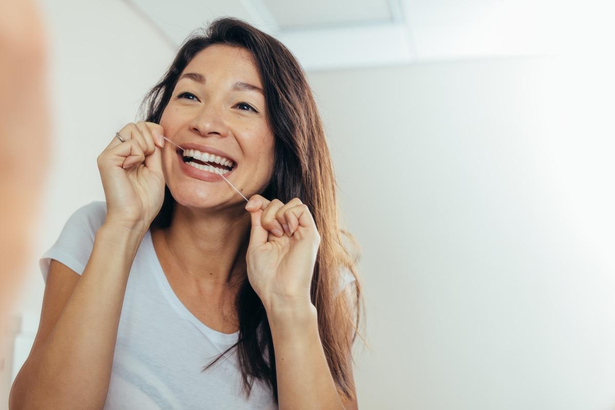Woman flossing