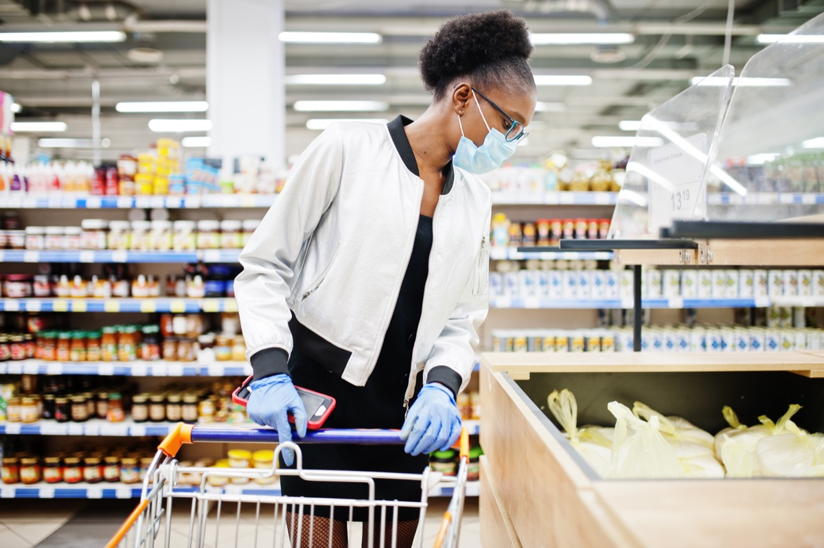 Woman wearing mask shopping in grocery store
